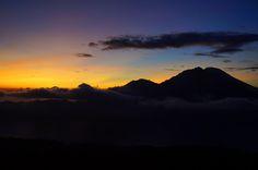 Watching a colourful sunrise atop Mount Batur, Bali, Indonesia.