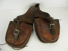 This is a set of vintage rodeo cowboy saddlebags maker marked Jim Houston Championship Rodeo Equipment of Burkburnett,Texas.