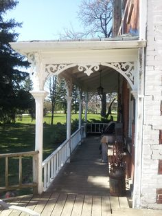 Gorgeous dream porch - lovely balustrade all wooden. On an 1870s farmhouse in Ontario - totally my style!