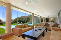 High up in a most sought after cul-de-sac with sublime sea views. Large 1942sqm erf of level lawned garden. This home flows to huge entertainment decks, pool and jacuzzi. Designed for entertainment. Theatre, bar, games rooms and pool room all flow to lawned garden. Formal and informal living areas, study, open plan eat in kitchen & family room. 6 Car garaging plus off street parking for 6 cars. Double staff quarters.