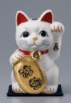 Cats are considered to invite people and fortune into their homes, therefore manekineko have one paw raised to beckon them inside.