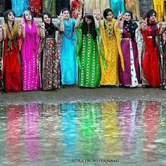 Kurdish Women in beautiful colorful Dresses.
