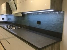 Beautiful finish... DecoKiln - Stack 8 mm toughened glass splashback painted with our DecoLuxe - Cirrus metallic colour.