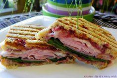 Raspberry ham panini: Seeded rye bread,raspberry preserves, baby spinach, sliced deli ham, muenster cheese, butter spread
