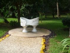 Loved this chair in the garden area of the Ik Kil Cenote near Chichen Itza, Mexico.   Go to www.YourTravelVideos.com or just click on photo for home videos and much more on sites like this.