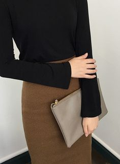 Accessorize your minimalist look with a modern solid tone clutch!