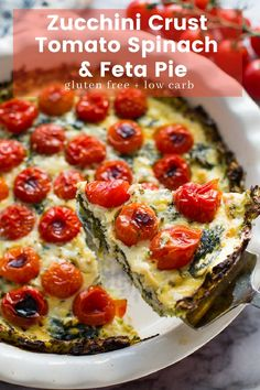 Seven ingredient + low carb Tomato Spinach Feta Pie with an easy zucchini crust - delicious as a simple weeknight dinner or weekend brunch! | #GlutenFree + #GrainFree + #LowCarb #zucchinicrust #lowcaloriedinner #healthydinner #summerrecipes #Keto #KetoRecipes