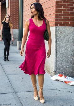 Strutting her stuff:The Top Chef host looked elegant in the pink dress which clung to her shape and exhibited her ample bosom and tiny waist