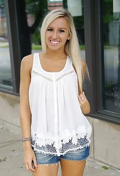 Sleeveless tank top with lace detail.