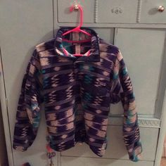PATAGONIA SYNCHILLA  As much as it pains me to list this, it has to be done. I'm not wearing it! That's just not right!!! This is a hard to find print by Patagonia, men's size small (equivalent to a women's xs or small or even medium!) it's soft and WARM and I just can't get past the awesome blue print! SIGH.  Buy it before I change my mind! You won't regret it!  I take reasonable offers and I love bundles! Check out my other stuff! Patagonia Sweaters