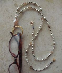 """This eyeglass necklace has a magnetic clasp and can double as a badge lanyard. Handcrafted with crystals, pearls and a beautiful lampwork focal bead by <a href=""""http://arepaki.etsy.com"""" rel=""""nofollow"""" target=""""_blank"""">arepaki.etsy.com</a> $23.00"""