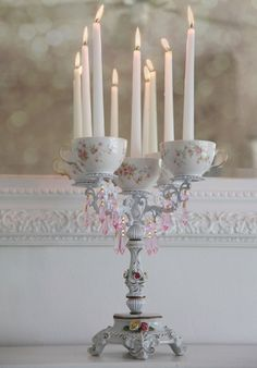Romantic Porcelain Teacup Candelabra (inspiration only) I LOVE this, and would make burning the candles safer since it would contain wax drips as well.
