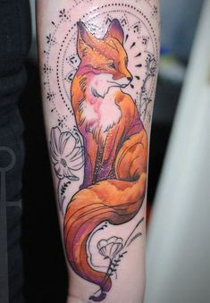colored fox tattoo on forearm