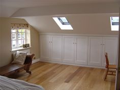 attic angled storage, and laminate flooring