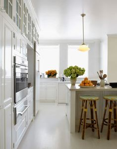 Gleaming Kitchen  The kitchen gleams with white on white: Farrow & Ball's White Tie, in high gloss on the walls, and Fine Paints of Europe's White, in high gloss on the woodwork and in flat on the ceiling.