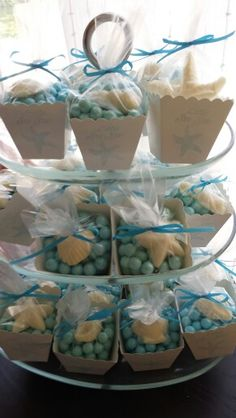 """The Favors: Blue Pearl Sixlets and shell candies made with a mold; white popcorn favor boxes from Amazon stamped that I stamped with a blue starfish and """"little sea star"""" stamp"""
