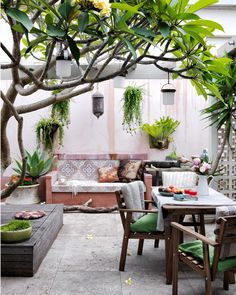 Bring cushions and lanterns outside to set the scene for a relaxed alfresco…