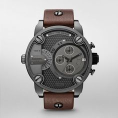 "DIESEL SBA  $295.00 Style #: DZ7258    This Diesel watch features bold screw and logo plate detailing, gunmetal dial and case, and genuine brown leather strap. These details combine with the offset chronograph for a ""wow"" look that's also wearable."