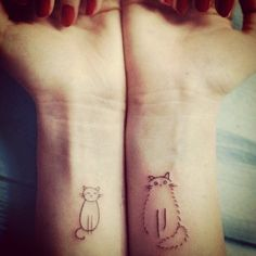 Cute Cat tattoo designs on both wrists.