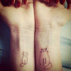 Cute Cat tattoo designs on both wrists.