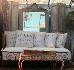 beautiful rusted, books, pillows, mirror. I love this look, great background for photos.
