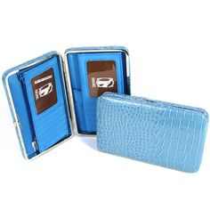 "Wallet - Baby Blue with Snake Skin Texture  Product # [WL1270]    7"" L 4.5"" H 1"" D, Deep, Thick Hinge Wallet With Snap Lock Closure, PVC Trim. Blue Interior with 8 Card Slots, 2 ID Holders, Removable Checkbook Cover. 2 Interior pockets divided by Zipper. Exterior snap coin pocket.     $29.99"