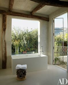 Shapiro conceived the master bath so that the minimalist tub has views of the garden and the Malibu hills | archdigest.com