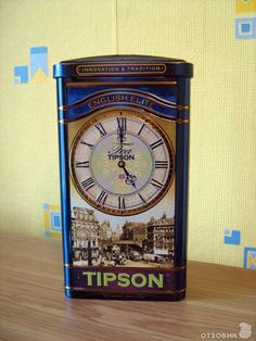 Tipson Tea tea tin decorated with clock face (hands at 5 o'clock) and photo of Victorian street scene, on dark blue background Victorian Street, Relaxing Tea, Clock Shop, Film Making, Tea Tins, Dark Blue Background, Tea Box, Tea Caddy, Vintage Tins