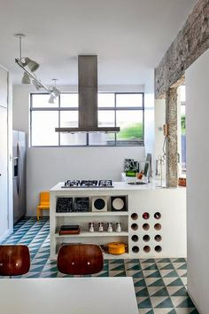 We love this kitchen! You can keep your triangles organized in a continuous pattern as they have done here.