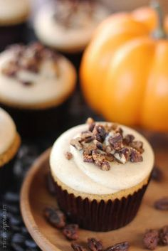 Pumpkin Pie Cupcakes Topped with Maple Buttered Pecans.