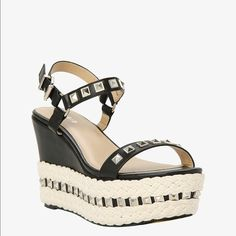 """Super Cute Wedge Wide Width Brand New Still in box. The left shoe is still wrapped up. Never worn.  this jute style is a one-of-a-kind. It mixes sleek black faux leather with ivory jute, which adds a rope-like texture. Allover silver tone studs cap this look off with an edgy touch.4 1/2"""" wedge with 1 3/4"""" platform. Adorable!! torrid Shoes Wedges"""