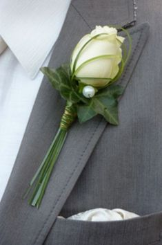 Boutonnière with bud rose wrapped in grass