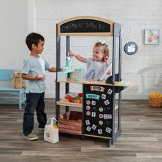 Watch your little entrepreneur quickly calculate the fun that this KidKraft Let's Pretend Shopkeeper Stand will bring. Whether it's something as simple as a lemonade stand or something more unique—like a fresh produce shop or an ice cream cart, kids wil Kids Playroom Furniture, Kids Rooms, Market Stands, Fabric Tote Bags, Let's Pretend, Shops, Crate Storage, Hanging Signs, Display Shelves