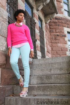 preppy look: pastel jeans + candy pink sweater layered over a button down shirt
