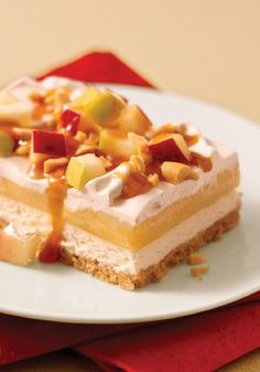 Caramel Apple Dessert -- Each layer of this recipe is better than the last, from the crunchy crust to the sweetened cream cheese, vanilla pudding and, finally, fresh bites of apple topped with caramel and peanuts.
