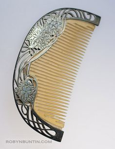 Silver Japanese hair ornament with tortoise shell teeth, ca 1915. Marvelous comb design in silver with incised design of chrysanthemums.  Taisho period.