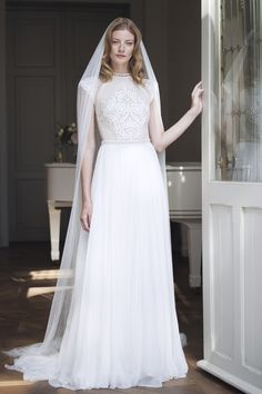 Divine Atelier wedding dress with cap sleeves.