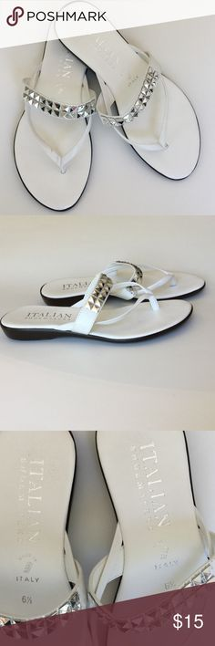 Italian Shoe Makers Sandals HP   Italian Shoemakers White Summer Sandals. Pretty white flip flop style with accent band across foot of bling. Sharp and fun. Very good condition. Size 6 1/2. Strap across instep measures 7 1/8 at smallest part. Across widest part of sole at ball of foot 3 1/2 inches. Across heel 2 1/4. Length of shoe is 9 1/4. Inside flip flop strap 4 1/2. Outside flip flop strap 5 inches. Italian Shoemakers Shoes