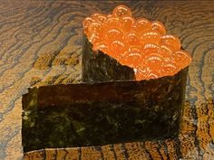 Marinated fresh salmon roe in soy wrapped in black seaweed paper on rice.  Today's best.