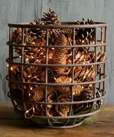 Our round metal basket is dripping with vintage farmhouse appeal. For more rustic metal baskets visit Antique Farmhouse. Farmhouse Christmas Decor, Primitive Christmas, Rustic Christmas, Winter Christmas, Christmas Home, Christmas Crafts, Cabin Christmas Decor, Christmas Ideas, Pine Cone Christmas Decorations