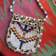 Lakota Sioux Fully Beaded Woman's Handbag 1890's ~ A lovely early reservation period Lakota Sioux fully beaded woman's handbag. This is a unique example of the interplay between white and Indian cultures as it shows the strong influence of Victorian designs on traditional Native American items.