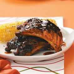 Sweet and Spicy Jerk Ribs-This no-fuss recipe takes just minutes to prepare. With its sweet, fruity sauce, these ribs will become an anytime favorite for the whole family Slow Cooker Ribs, Slow Cooker Recipes, Crockpot Recipes, Cooking Recipes, Pork Ribs Grilled, Pork Ham, Pork And Beef Recipe, Rib Recipes, Yummy Recipes