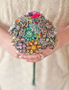 Multi coloured brooch bouquet - 10 Beautiful Brooch Bouquets to Inspire your Wedding Look - Wedding Blog   Ireland's top wedding blog with real weddings, wedding dresses, a...