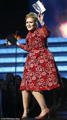r Best Pop Solo Performance for her song Set Fire To The Rain at the 55th annual Grammy Awards