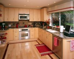 Red Accent Kitchen With Diffe Wood Cabinets Redo