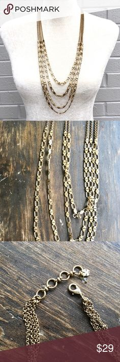 Long Lucky Brand Necklace Gently used 4Strand Lucy Brand Necklace Long and chunky, Aztec patterned  Not heavy compared to it's thickness Antique/brassy toned gold Pictures reflect the real tone and look of the necklace Looks very cool I usually not wear earrings when my necklace has a good statement look such as this :0) Lucky Brand Jewelry Necklaces