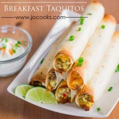Baked Breakfast Taquitos – crispy, cheesy, and full of delicious goodness and best of all they're baked! Taquitos for breakfast! Brilliant!