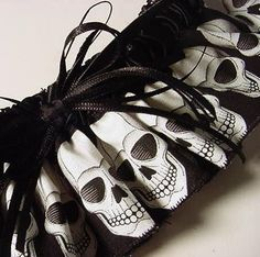 Wedding garter Goth Skull Garter Wedding Bride Black and White Punk Rocker. $22.00, via Etsy.