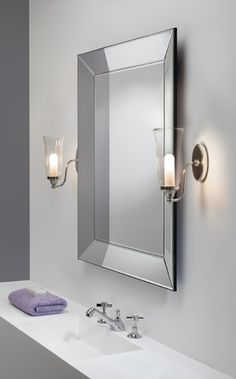 the biarritz bathroom wall light has a polished chrome finish with a clear glass shade rated and supplied with a lamp fully dimmable astro 7137 astro lighting evros light crystal bathroom