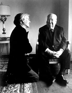 Andy Warhol and Alfred Hitchcock chat in 1976